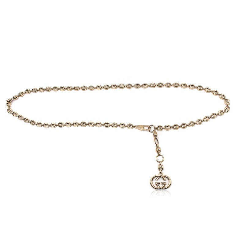 Gucci Gold Tone Mariner Link Chain Belt  -Chain belt with 'GG' charm -Lobster clasp closure -Adjustable length  Please note, these items are pre-owned and may show signs of being stored even when unworn and unused. This is reflected within the