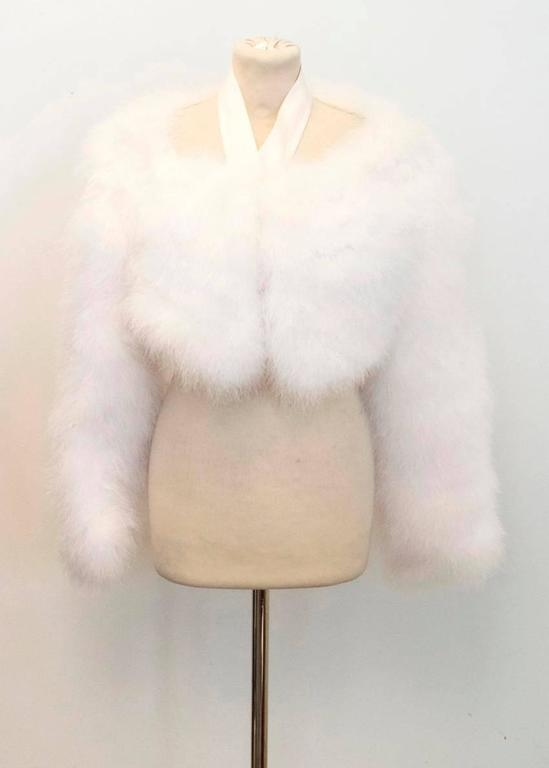 Tom Ford for Gucci white marabou feather bolero. SS 04 collection featuring a white satin halter-neck collar, rose gold hook and eye fastening on the neck and long sleeves, the bolero is fully lined in silk. Size 42.