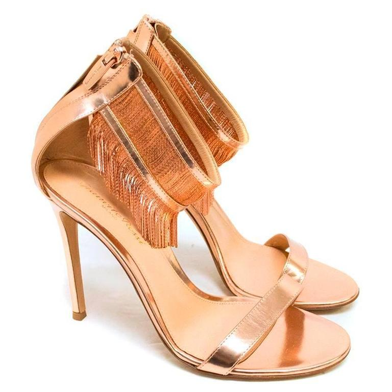 60d107ebb2d Gianvito Rossi metallic rose gold metal fringe heeled sandals. Leather  straps and zip detailing