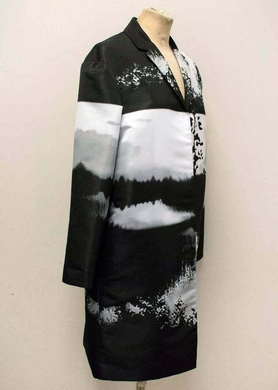 Mary Katrantzou monochrome printed, lightweight, mid length, oversized coat with a small notch lapel and no closure. 