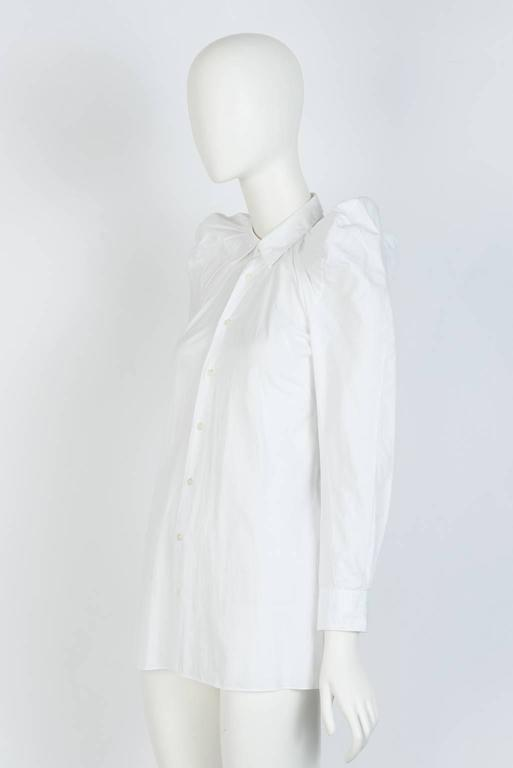 From Junya Watanabe 2009 Collection, this cotton fiited shirt features a gathered neckline, creating an exaggerarted shoulder with a tuxedo back design.