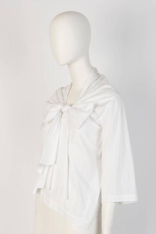 White cotton three quarter sleeve top with gathered big bow tie design in front. From 2013 tricot COMME DES GARÇONS collection.