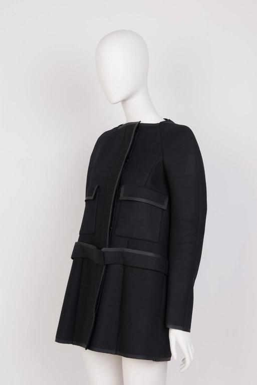 Nicolas Ghesquière's futuristically tailored, off body, with belt, thigh-length.