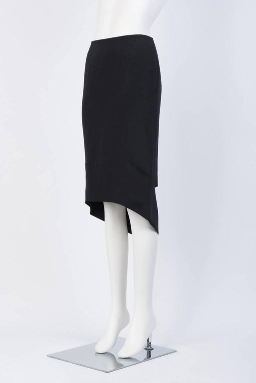 Crêpe de Chine skirt with asymmetrical hem and cut out detaiing in back.