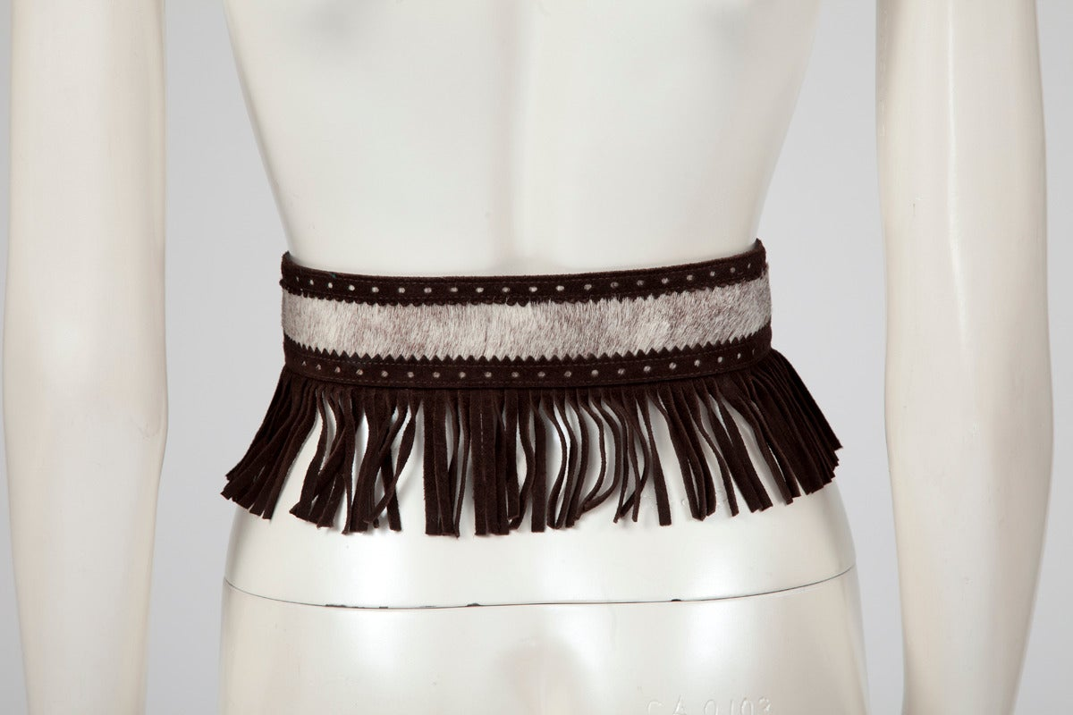 """Early 80's YSL natural pony skin and brown fringed suede belt. Labeled size """"medium"""", the width of the belt is approx. 12 cm (4.7 inches) with the fringes and 5 cm (2 inches) without.   Fits approx. : US 2-6 (small US 6) / FR 36-38 (small FR"""