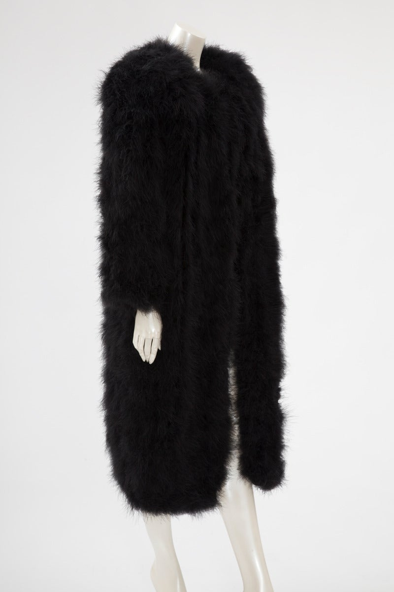 Late 80's - early 90's Sonia Rykiel black marabou coat. Single fur hook and eye closure at neck level. Though labeled a French size 42 (US 10), this piece runs a little small to size. Fully lined in black acetate. Shoulder pads removal possible for