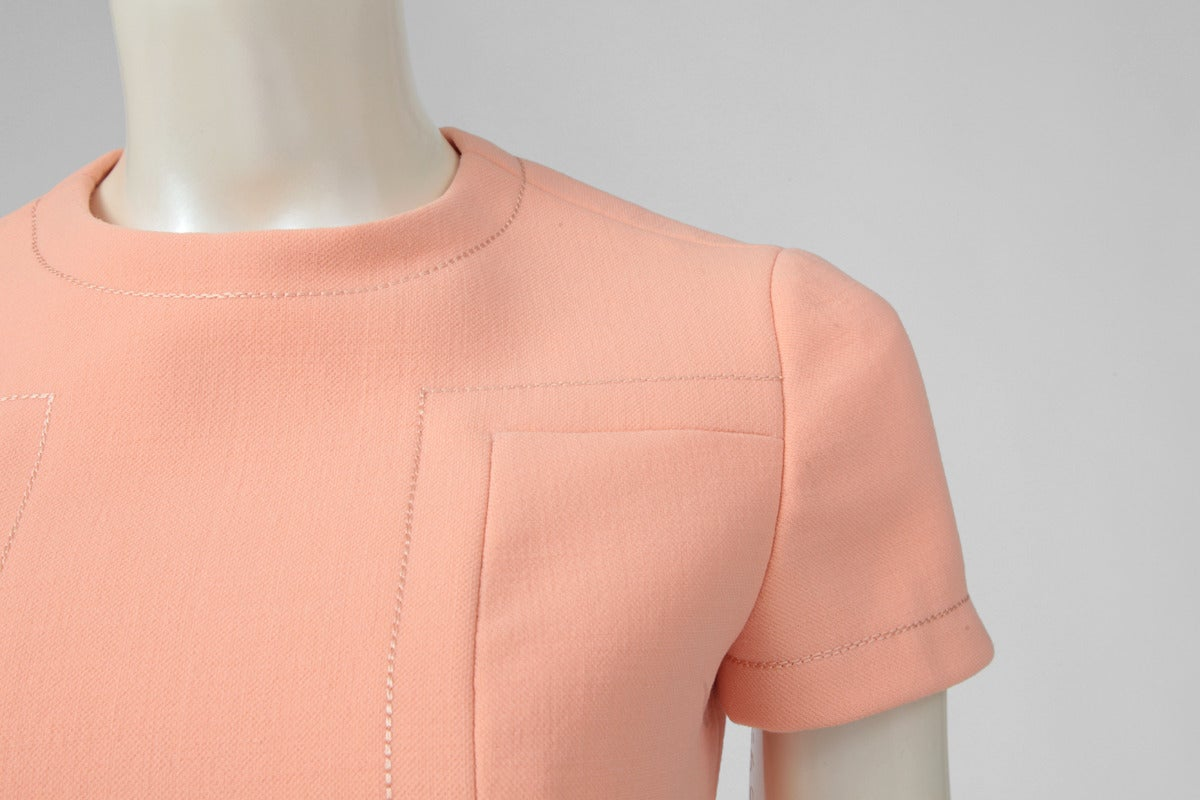 This circa 1968 ravishing Jean-Louis Scherrer light peach dress is a great option for daytime events. The dress has an extremely flattering cut, skimming the body until the waist level. Stitching details in the front, at the back and at the end of