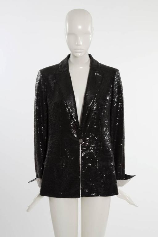 """From the 2009 Cruise collection, this Chanel all-over black sequins blazer is the epitome of the """"glam rock"""", but chic attitude ! Double lapel collar. Cuff and collar reverse in white satin (see pictures 7 & 8). One mirror button front closure. The"""