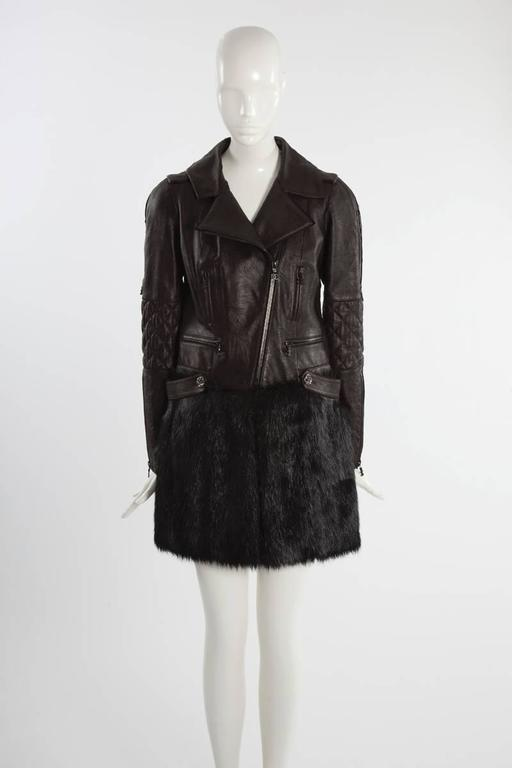 With this extremely rare (only a few were made) Chanel runway (look 11 -> see picture 10) brown quilted lambskin and black faux fur coat, Karl Lagerfeld transforms the classic winter coat into an edgy biker-inspired style (biker-inspired silhouettes