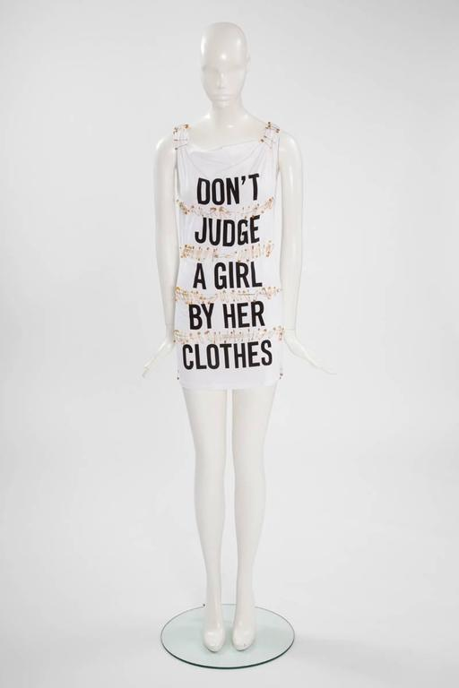 Humorous creations were one of the characteristic of Franco Moschino. Julia's Dressing is pleased to offer this safety pin cotton mini dress which reflects the Punk movement in a funny sexy provocative way. Labeled an Italian size 40 (US 6).