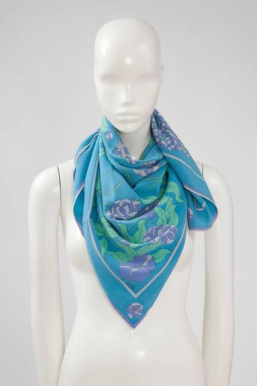 60's Emilio Pucci silk scarf with a lovely and unusual floral pattern. Rolled edges. Emilio Pucci's signature is printed throughout the scarf. A great addition to any Pucci scarf collection or just drape it over a white tee or blouse for a polished