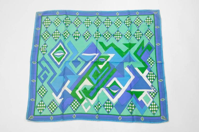 Emilio Pucci silk scarf with a wonderful geometric print. Rolled edges. Emilio Pucci's signature is printed throughout the scarf. A great addition to any Pucci scarf collection or daily use, just draping it over a white tee or blouse for a polished