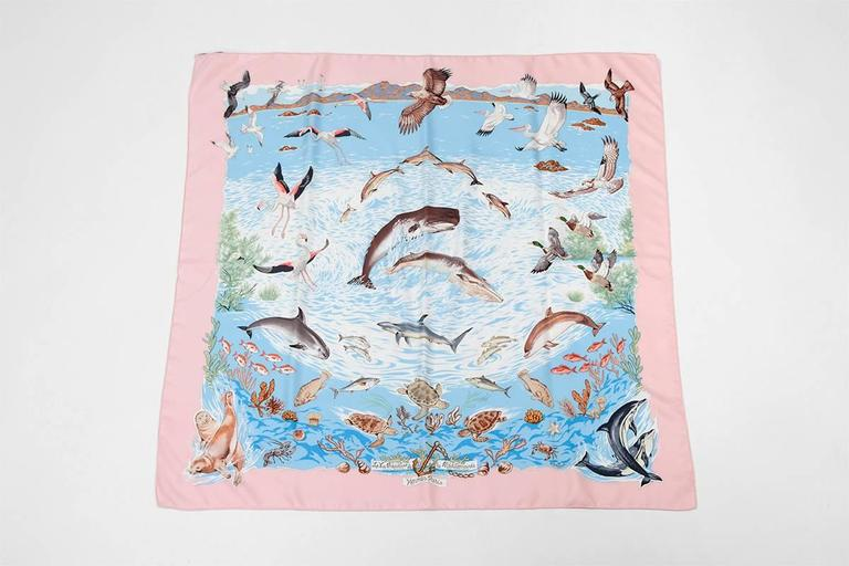 "Designed by Robert Dallet and first issued in 1992, ""La Vie Précieuse de la Méditerranée"" has been reissued in 2002. From the original edition, this beautiful scarf depicts Mediterranean life above and under the sea. Known for his nature oriented"