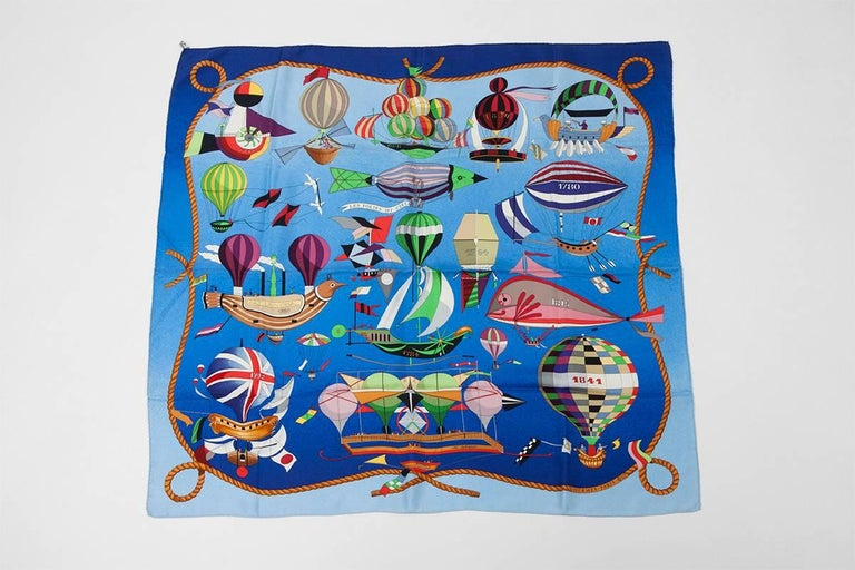 """Designed by Loïc Dubigeon and first issued in 1984, """"Les Folies Du Ciel"""" has been reissued in 1988 and 1994. Very much sought after by collectors, this carre scarf tells the insane courage of the first airmen, putting their lives at risk while"""