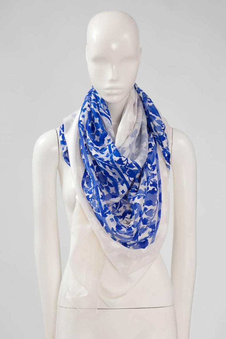"Reminiscent of the cobalt blue and white ""azulejo"" from Portugal, this vintage large YSL stole is a lightness and softness dream. Made in a refined jaquard silk chiffon, it measures 120 x 120 cm (47.2 x 47.2 inches). Not easy to picture - because of"