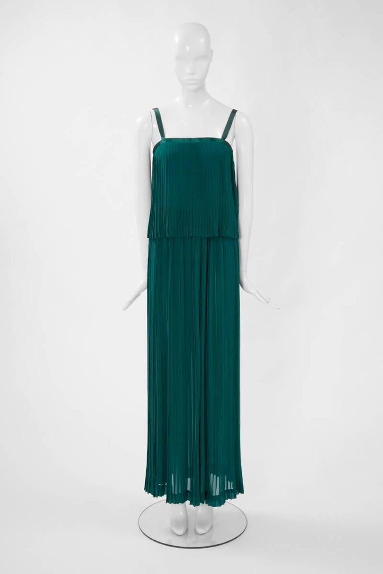 A wonderful addition to any summer wardrobe, this 70's runway Yves Saint Laurent Rive Gauche features a pleated jade green silk chiffon top with a matching elasticated maxi skirt (see picture 5). The top is finished with silk satin edges, used as