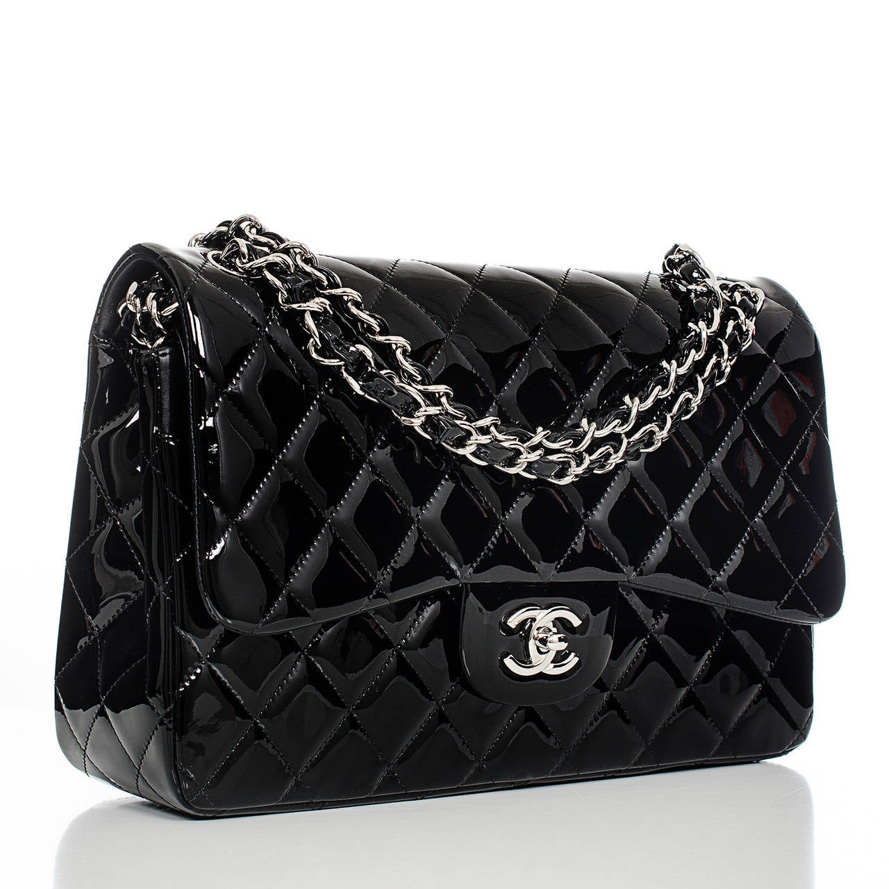 Chanel black Jumbo Classic double flap bag of quilted patent leather with silver tone hardware.