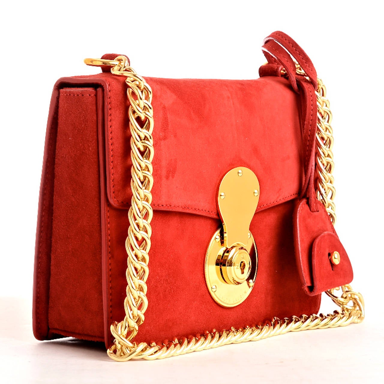 Ralph Lauren plush red suede Ricky Chain Bag with front flap with signature gold tone logo-embossed Ricky lock, matching removable key bell and gold tone chain link shoulder strap. Interior of black fabric with single open pocket on rear wall.