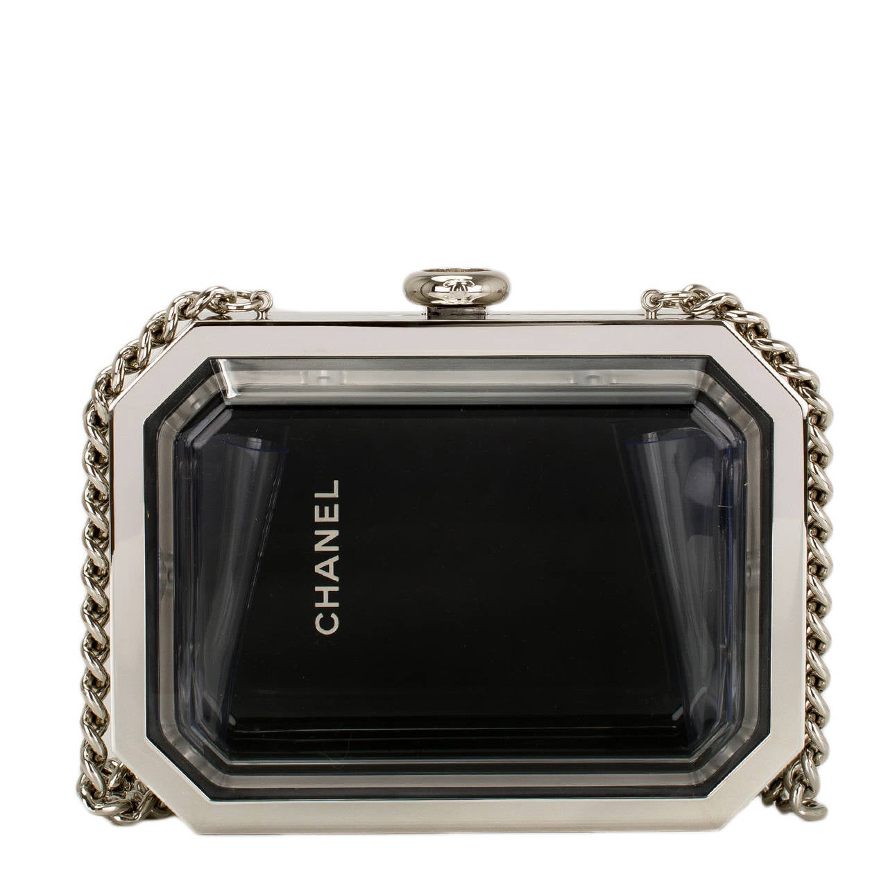 Chanel rare Premiere Watch minaudière bag of plexiglass with silver tone metal hardware.  Straight off the Chanel runway, this bag is exceedingly rare and looks fabulous when carried and equally fabulous displayed on the shelf of a Chanel lover.