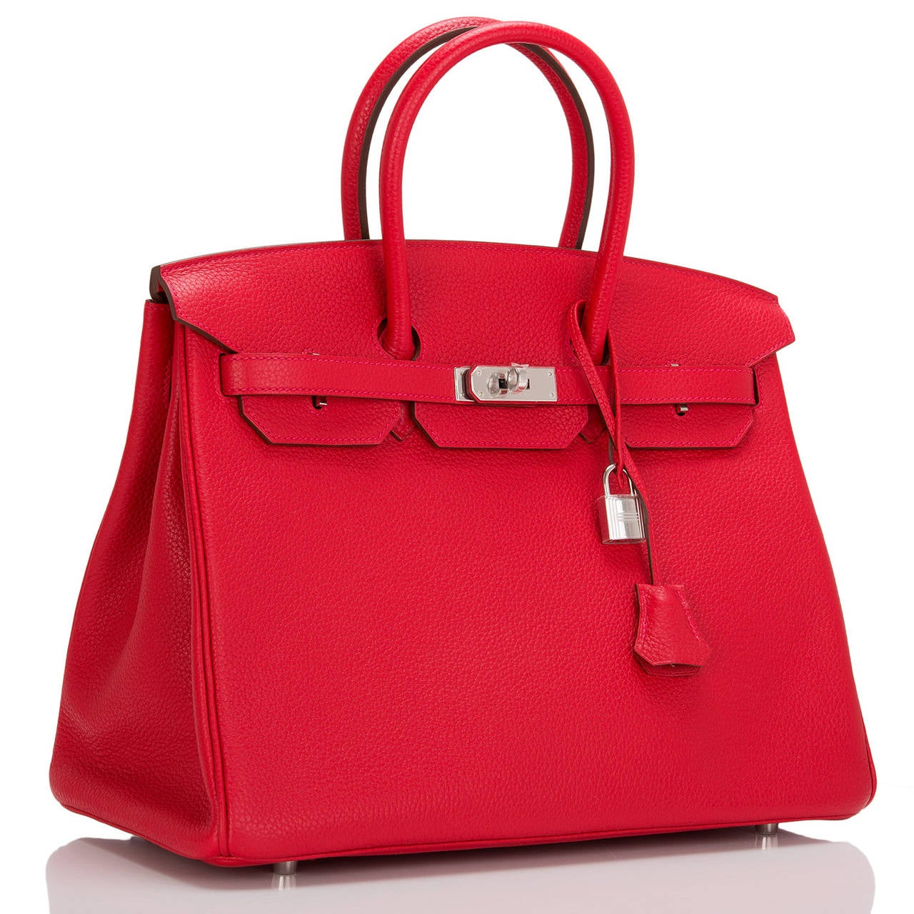 Hermes Rouge Casaque Birkin 35cm in clemence leather with palladium hardware.  This Birkin features tonal stitching, front toggle closure, clochette with lock and two keys, and double rolled handles. Interior is lined in Rouge Casaque chevre with