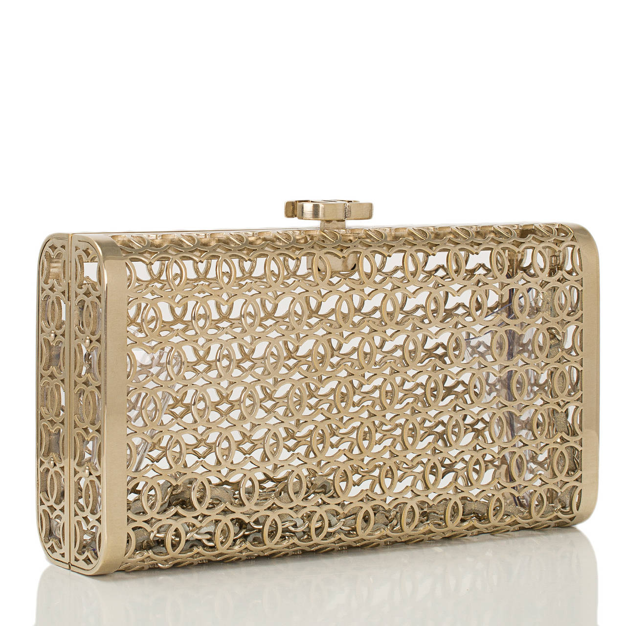 Chanel limited edition runway gold metal Moucharabieh minaudière with gold tone hardware.  This style features light gold metal CC latticework with top signature CC push clasp closure and an interwoven light gold tone chain link and light gold