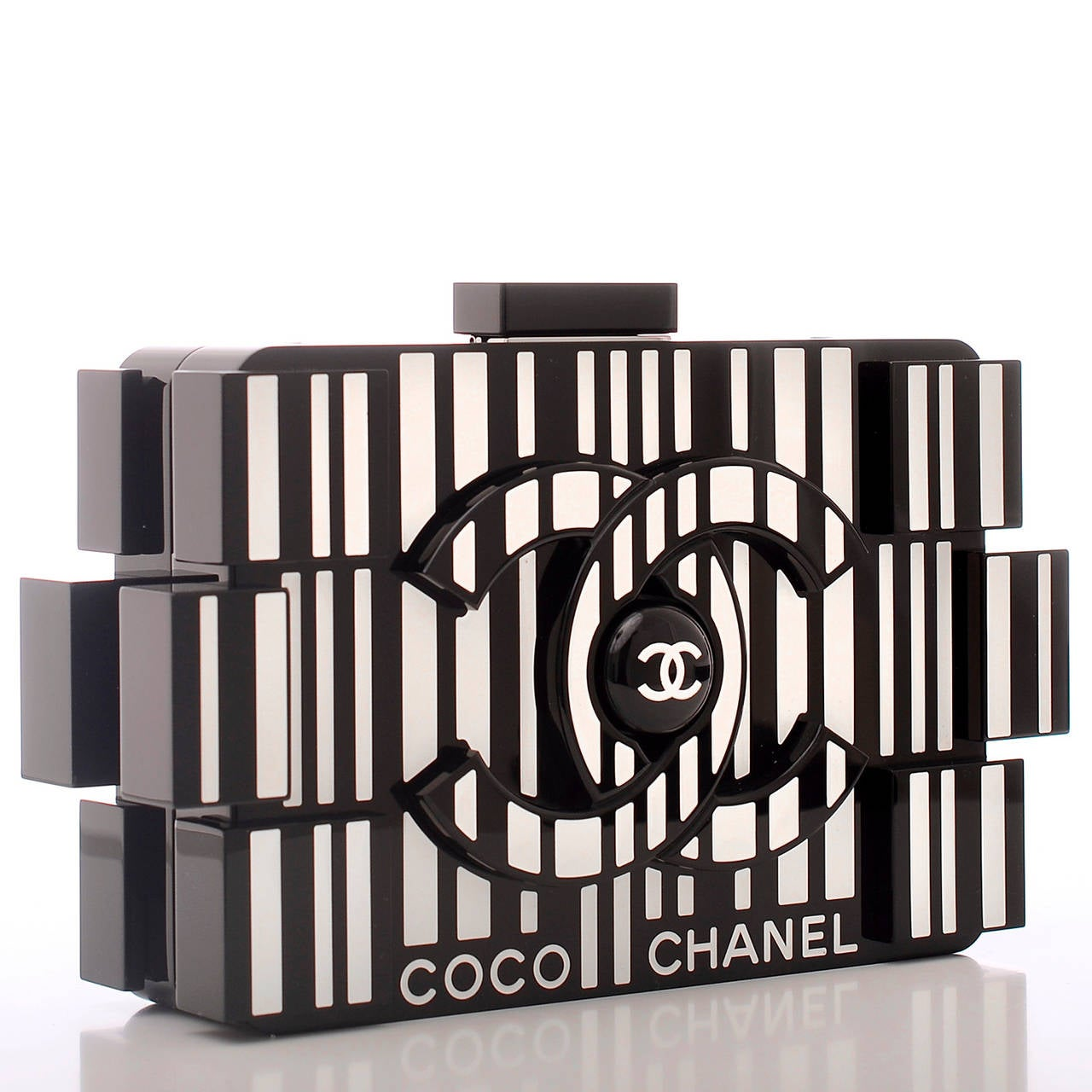 Chanel runway Op-Art Lego Boy minaudiere of black and white plexiglass with ruthenium hardware.  This rare, collectible bag features the signature CC logo at center front and back, top push closure and an interwoven ruthenium chain and black