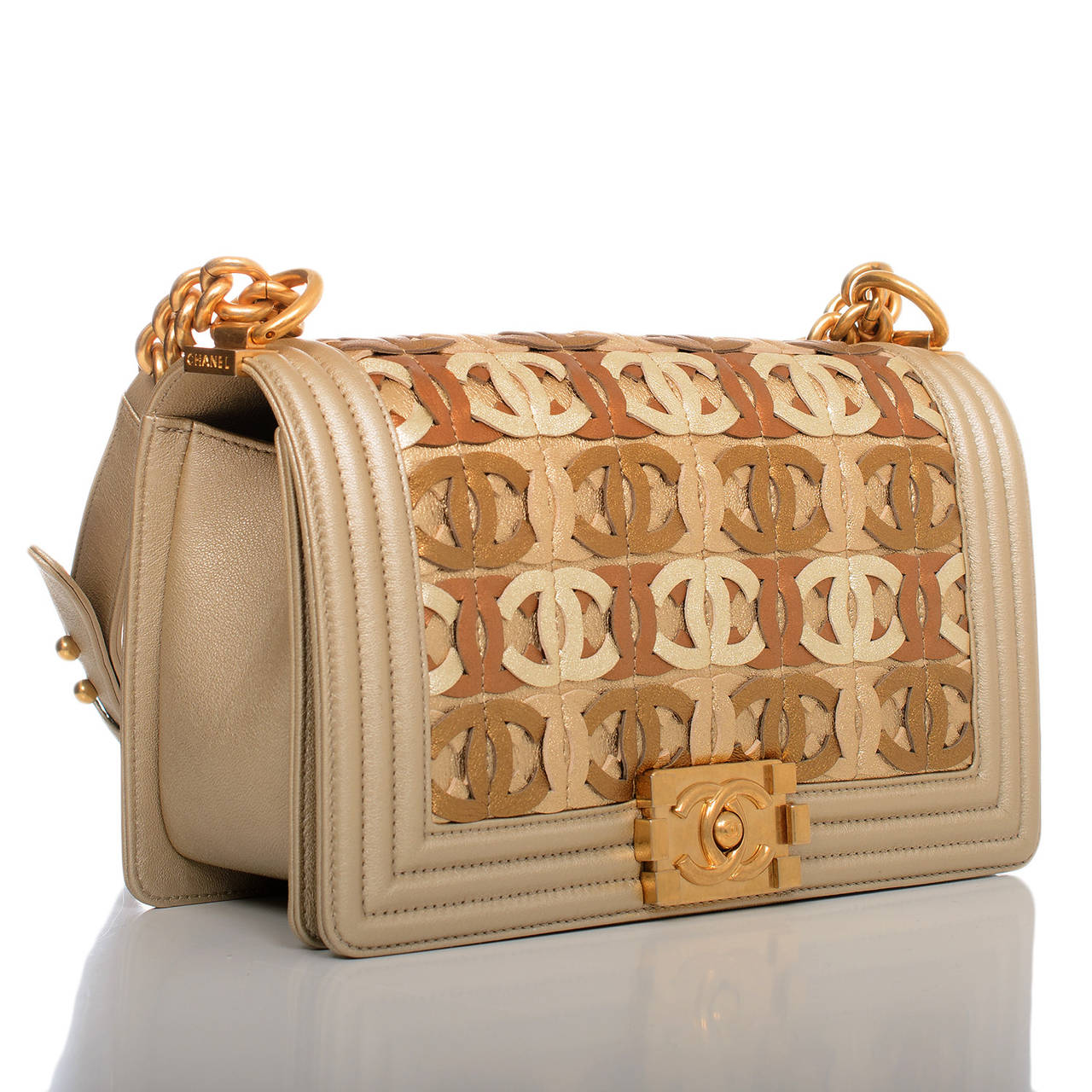 This limited edition bag was a highlight of Chanel's runway collection and is acclaimed by fashion blogs and fashion media worldwide as one of the top handbags of the season. The Medium boy marries gold metallic lambskin leather with antiqued gold