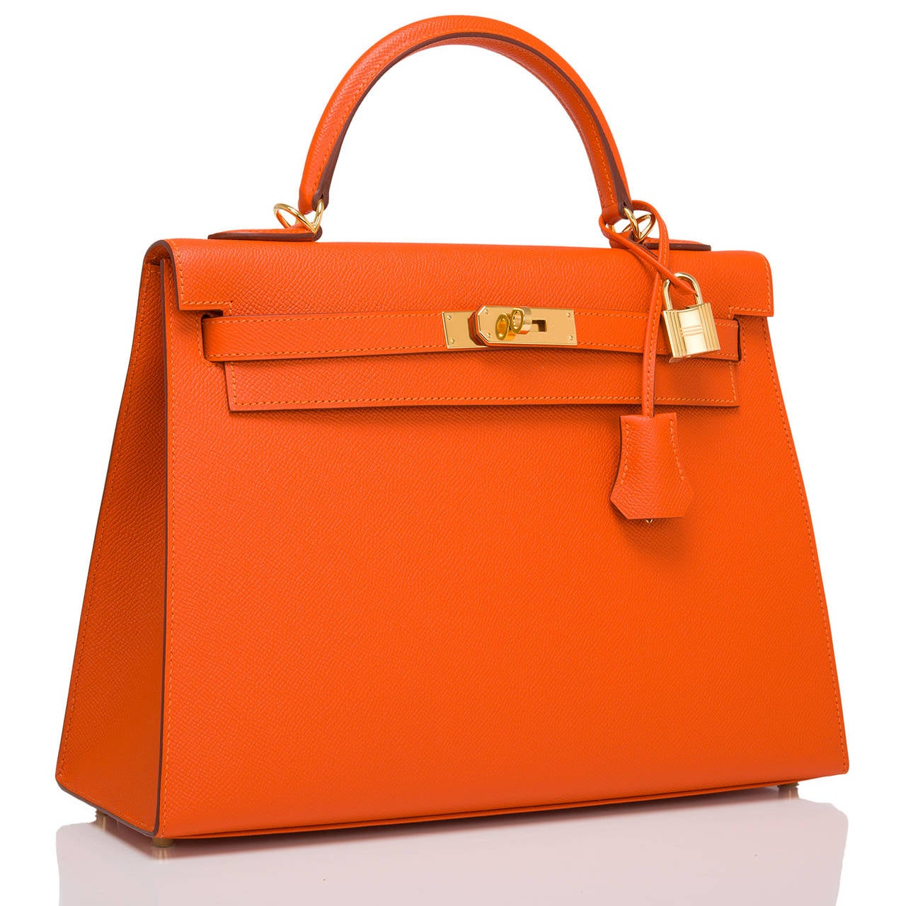 Hermes Orange H Kelly Sellier 32cm in epsom leather with gold hardware.  This Kelly features tonal stitching, front toggle closure, a clochette with lock and two keys and a single rolled handle. The interior is lined in Orange H chevre and