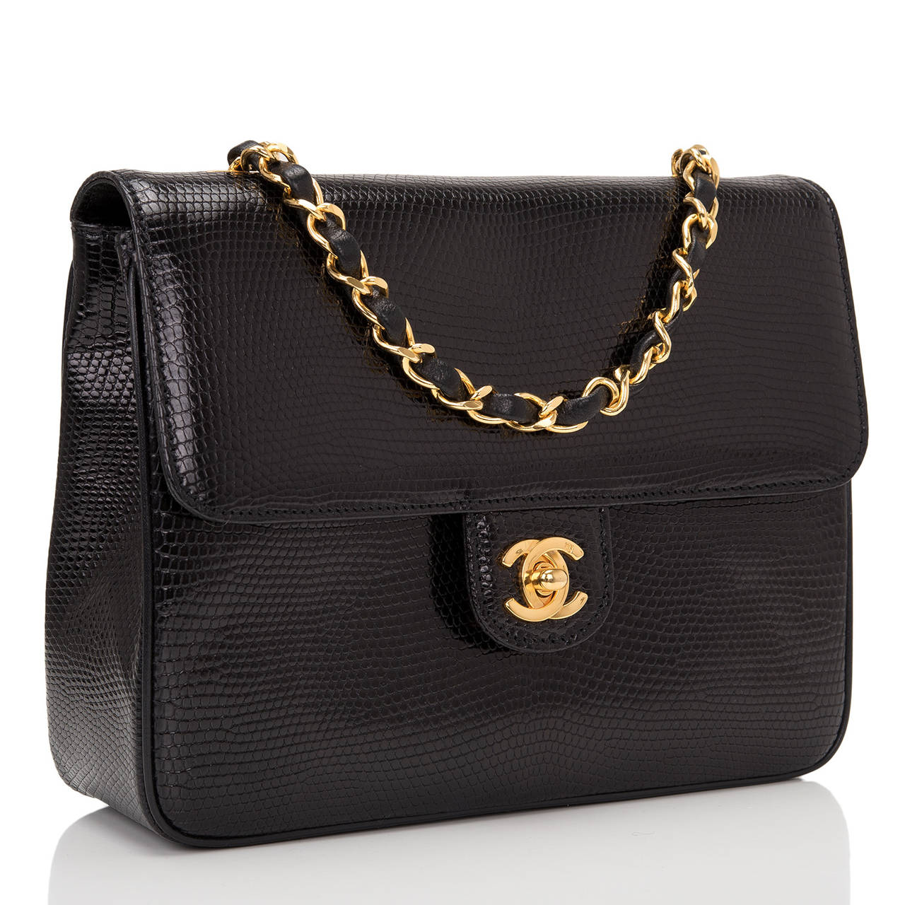 Chanel Large Classic Mini in black lizard with front flap and gold tone hardware, signature CC turnlock closure, and interwoven gold tone chain link and black leather shoulder strap.  The interior is lined in black leather with a zipper pocket