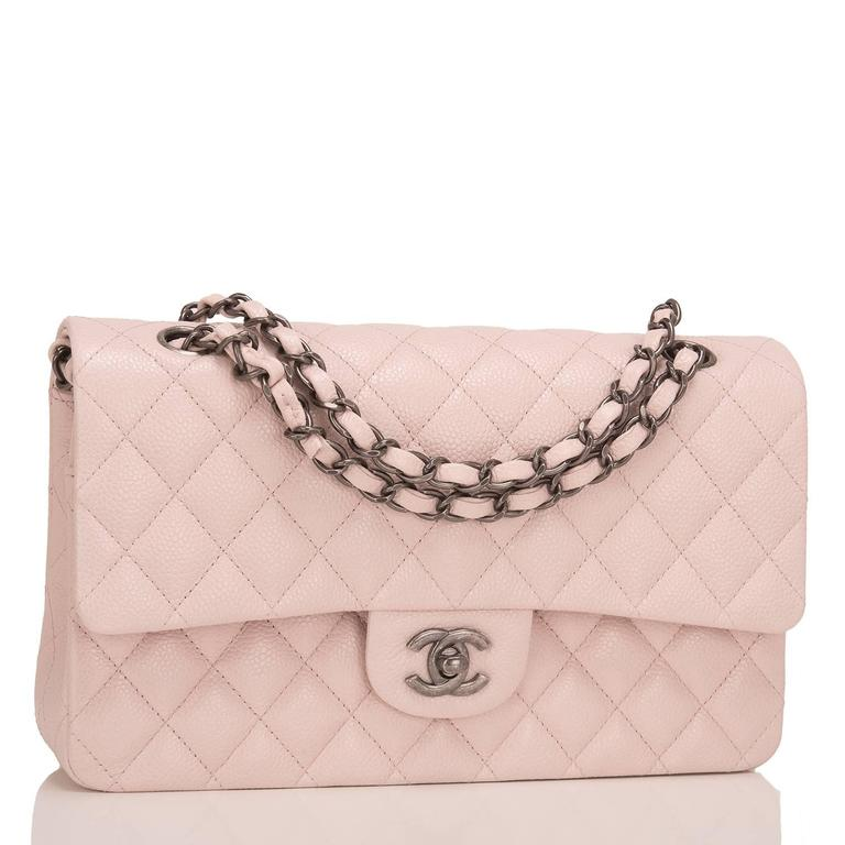 Chanel light pink Medium Classic Double Flap bag of quilted caviar leather accented with aged ruthenium hardware.