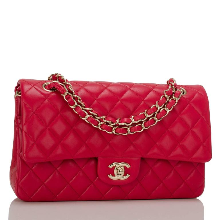 This Chanel red medium Classic Double Flap bag is made of quilted lambskin leather and accented with light gold tone hardware.