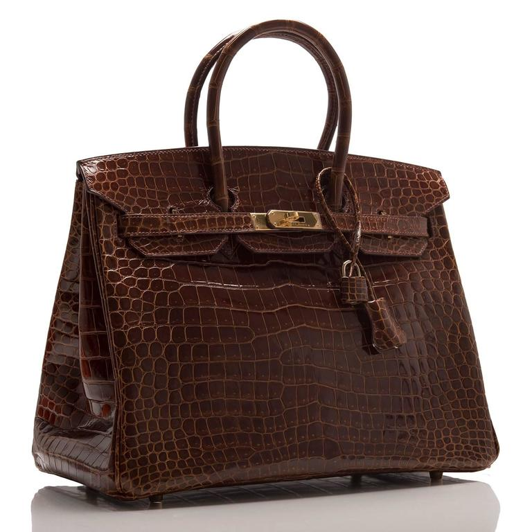 Hermes Cognac Birkin 35cm in shiny porosus crocodile leather with gold hardware.