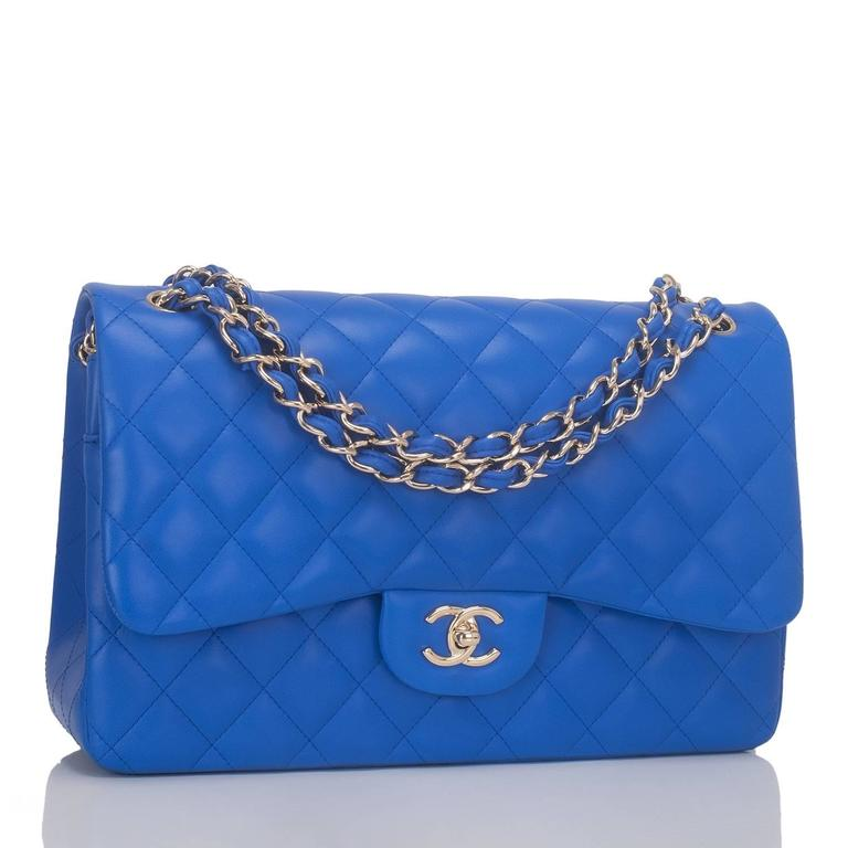 Chanel Jumbo Classic double flap bag of blue lambskin leather and light gold tone hardware.