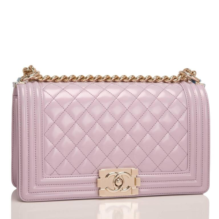 Chanel Medium Boy bag of light purple iridescent calfskin leather with light gold tone hardware.