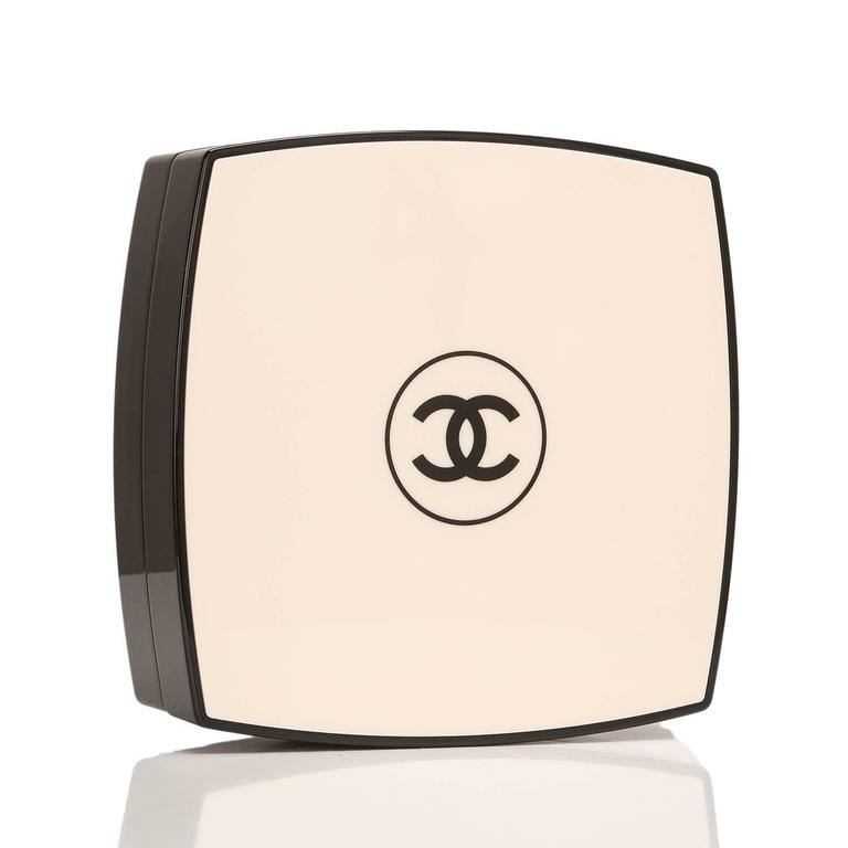 Chanel limited edition, runway Compact Powder minaudiere of white and black plexiglass with silver tone metal hardware.