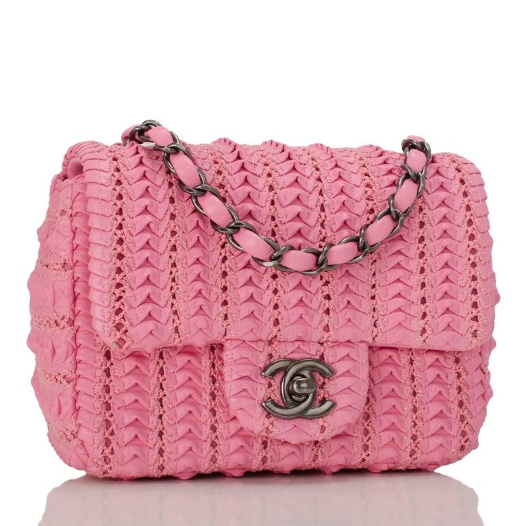Chanel Square Mini Flap Bag of pink embroidered lambskin leather with ruthenium hardware.  This limited edition runway bag has a front flap with CC turnlock closure and an interwoven ruthenium chain link with pink leather shoulder/crossbody