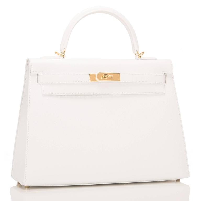 Hermes White Kelly Sellier 32cm of epsom leather with gold hardware.  This Kelly features tonal stitching, a front toggle closure, a clochette with lock and two keys and a single rolled handle.  The interior is lined with white chevre and has