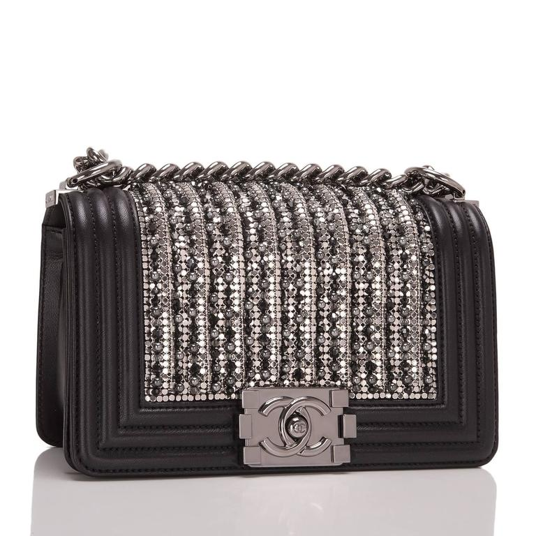Chanel limited edition Small Boy bag of black lambskin leather with ruthenium hardware.  This rare, collectible bag features a front flap with Le Boy CC push lock closure, metallic glass and pearl embroideries in black and silver, and a ruthenium
