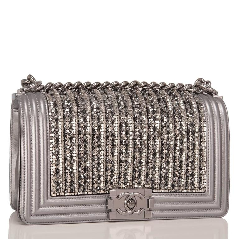 Chanel limited edition Medium Boy bag of silver lambskin leather with ruthenium hardware.  This rare, collectible bag features a front flap with Le Boy CC push lock closure, metallic glass and pearl embroideries in black and silver, and a