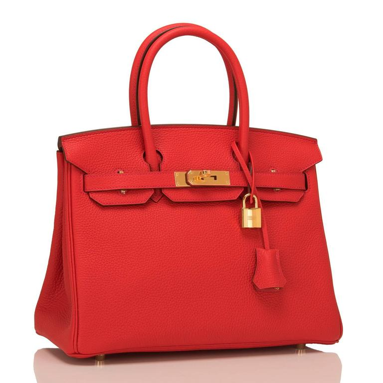 Hermes Birkin 30cm of Rouge Tomate of clemence leather with gold hardware.  This Birkin features tonal stitching, a front toggle closure, a clochette with lock and two keys, and double rolled handles.  The interior is lined with Rouge Tomate