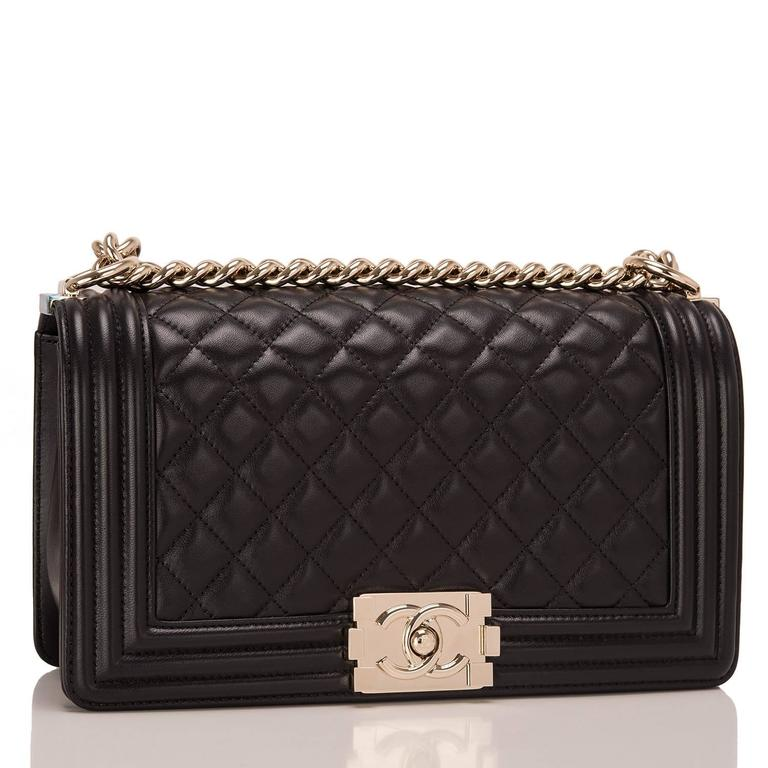 Chanel Medium Boy bag of black lambskin leather with light gold tone hardware.