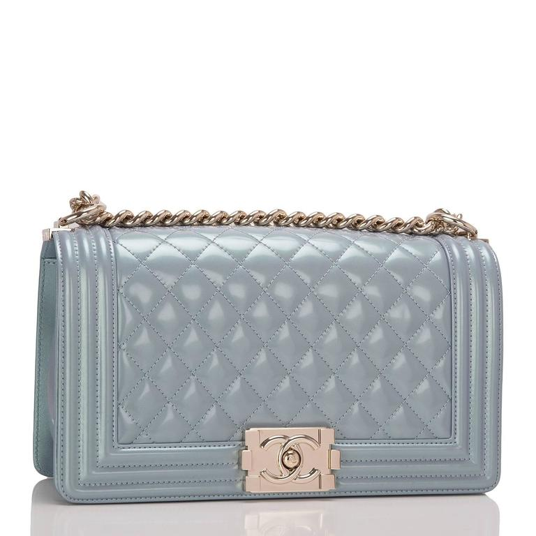 Chanel Medium Boy bag of light blue iridescent calfskin leather with light gold tone hardware.