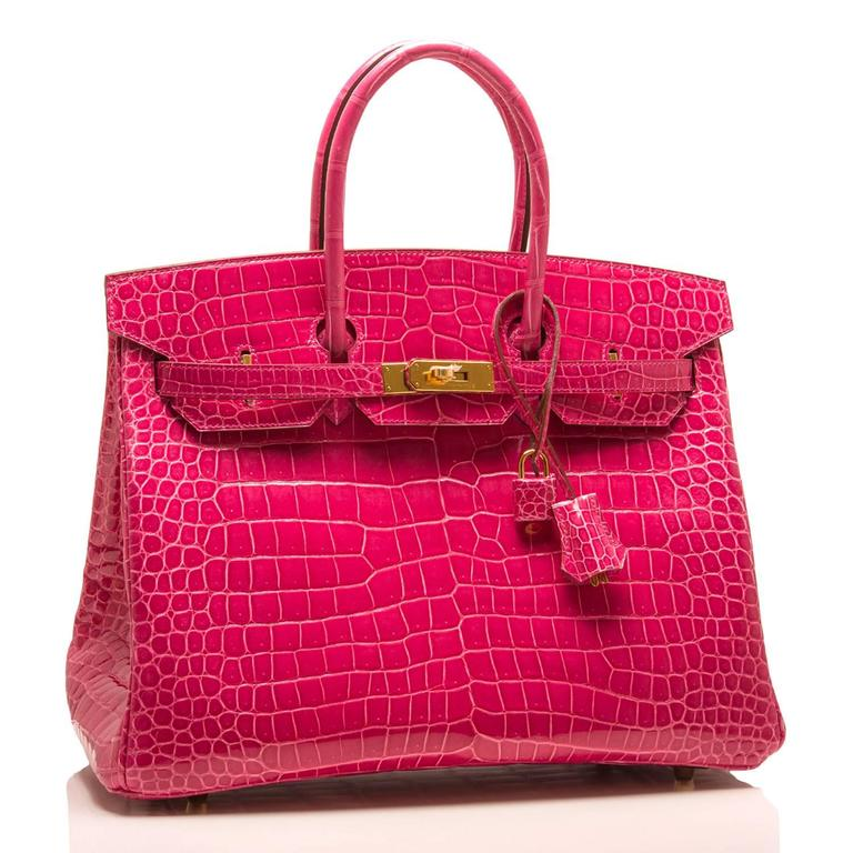 Hermes Rose Tyrien Birkin 35cm of shiny porosus crocodile leather with gold hardware.  This Birkin features tonal stitching, a front toggle closure, a clochette with lock and two keys, and double rolled handles.  The interior is lined with Rose