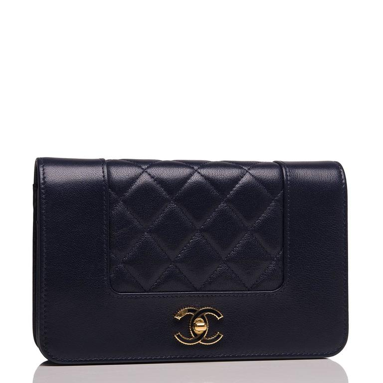 Chanel vintage style, Mademoiselle Wallet On Chain (WOC) of navy sheepskin leather with gold tone hardware.