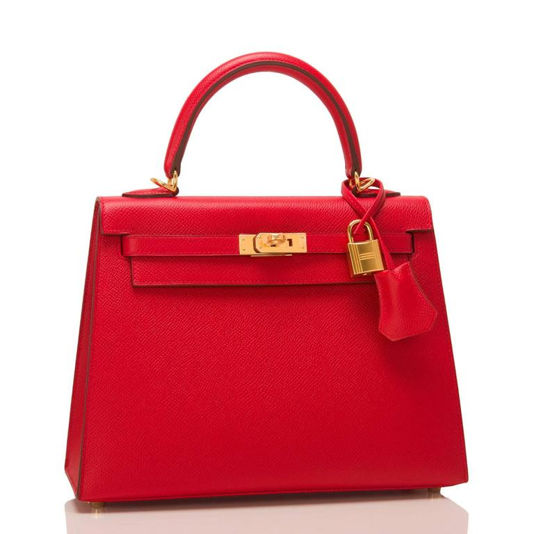 Hermes Rouge Casaque Sellier Kelly 25cm of epsom leather with gold hardware.  This Sellier Kelly has tonal stitching, a front toggle closure, a clochette with lock and two keys, a single rolled handle and a removable shoulder strap.  The