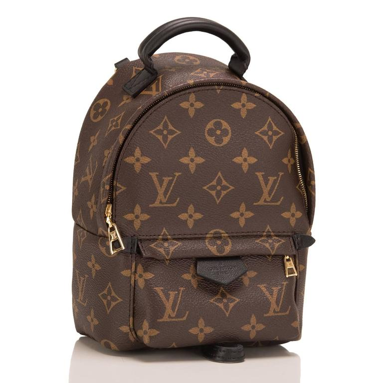 Louis Vuitton Monogram Palm Springs Backpack Mini designed by Nicholas Ghesquiere with golden brass hardware.