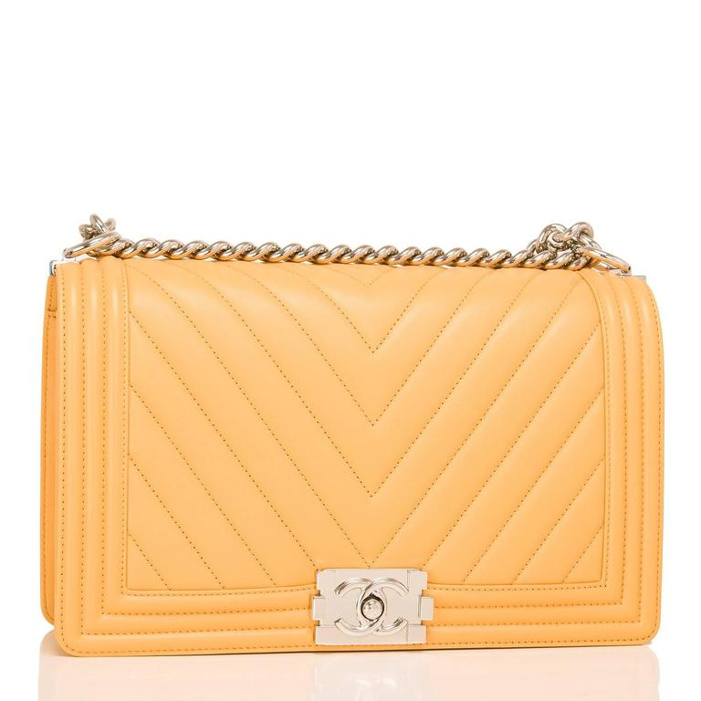 Chanel New Medium Boy bag of yellow chevron lambskin leather with silver tone hardware.