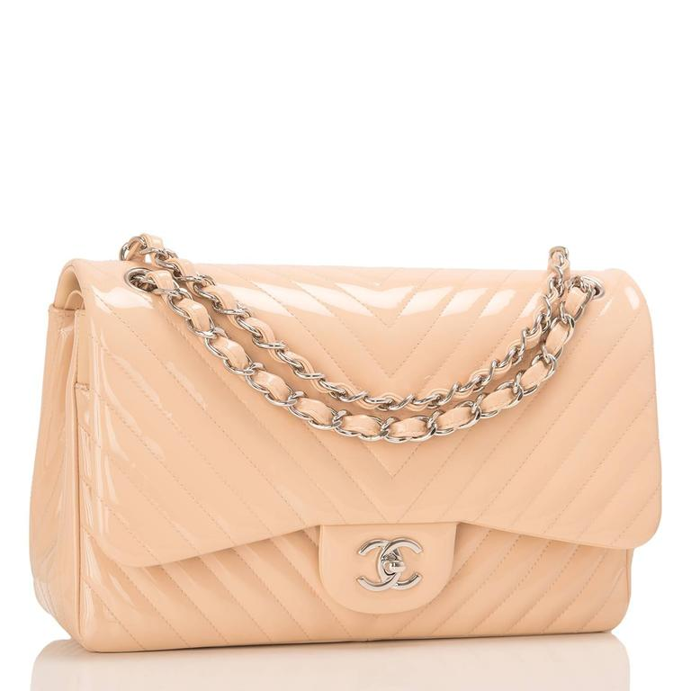Chanel Chevron Jumbo Classic double flap bag of beige quilted patent leather and silver tone hardware.