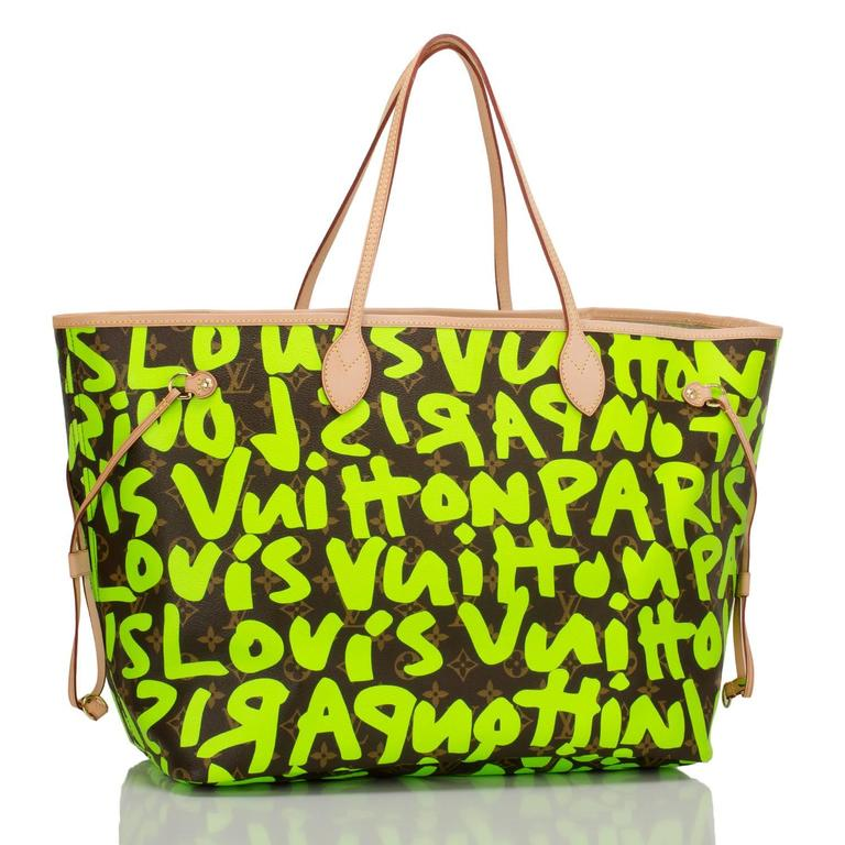 Louis Vuitton Green Monogram Graffiti Neverfull GM of coated canvas with silk screened bright fluorescent green colored graffiti lettering designed in tribute to Stephen Sprouse.