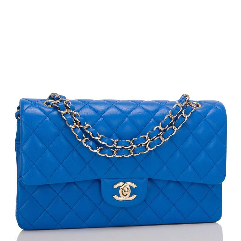 Chanel Medium Classic double flap bag of blue lambskin leather with light gold tone hardware.